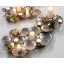 großer dekorativer oppulenter Kerzenhalter als ausgefallene Tischdeko