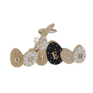 dekorativer origineller Schriftzug Ostern mit Hase, Blume und Punkten als ausgefallene Osterdeko